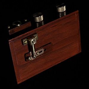 "The teak and brass ZeroImage 2000 pinhole camera, includes a film counter window, tripod socket, spirit level, cable release mechanism and circular exposure chart as its only ""features"". It exposes onto 120 roll film, giving 6x6 cm images"