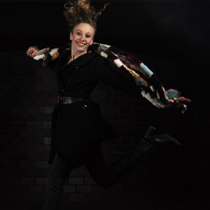 A small aperture & high shutter speed, coupled with off camera flashes allow the jumping model to be frozen in space, while also avoiding illumination of the background