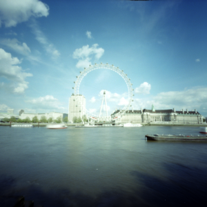 The London Eye is an enormous wheel on the south bank of the thames. With a 35mm camera it would easily fill the frame with a standard length lens. Using a pinhole camera though, it only fills 1/9th of the frame. To fill the frame the pinhole would need to be 2/3rds closer, in the middle of the river. A satisfactory shot is just not possible from this angle.