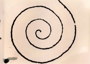 Print resulting from application of developer to the string spiral stamp.
