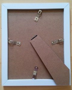 "An 8x10"" sized glass photo frame from a pound shop. The quick release clips allow easy changing of paper."