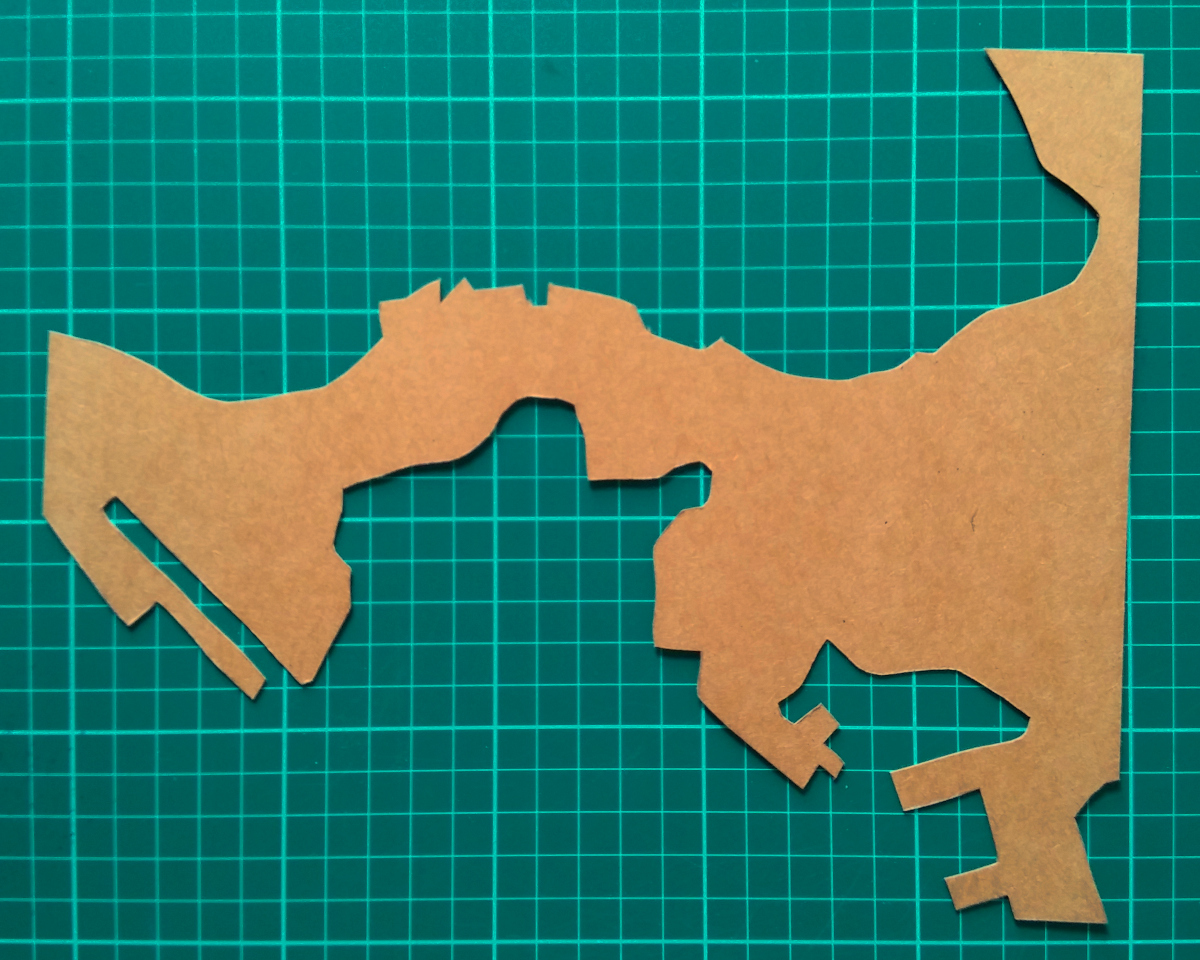 Cardboard stencil after being traced and cut from the paper outline